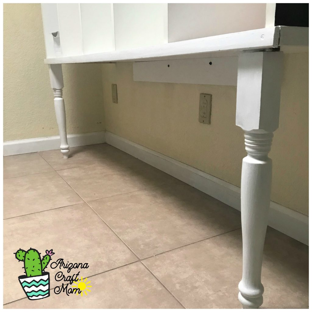 Use wooden table legs to add farmhouse touch to DIY mudroom family cubby organizer.