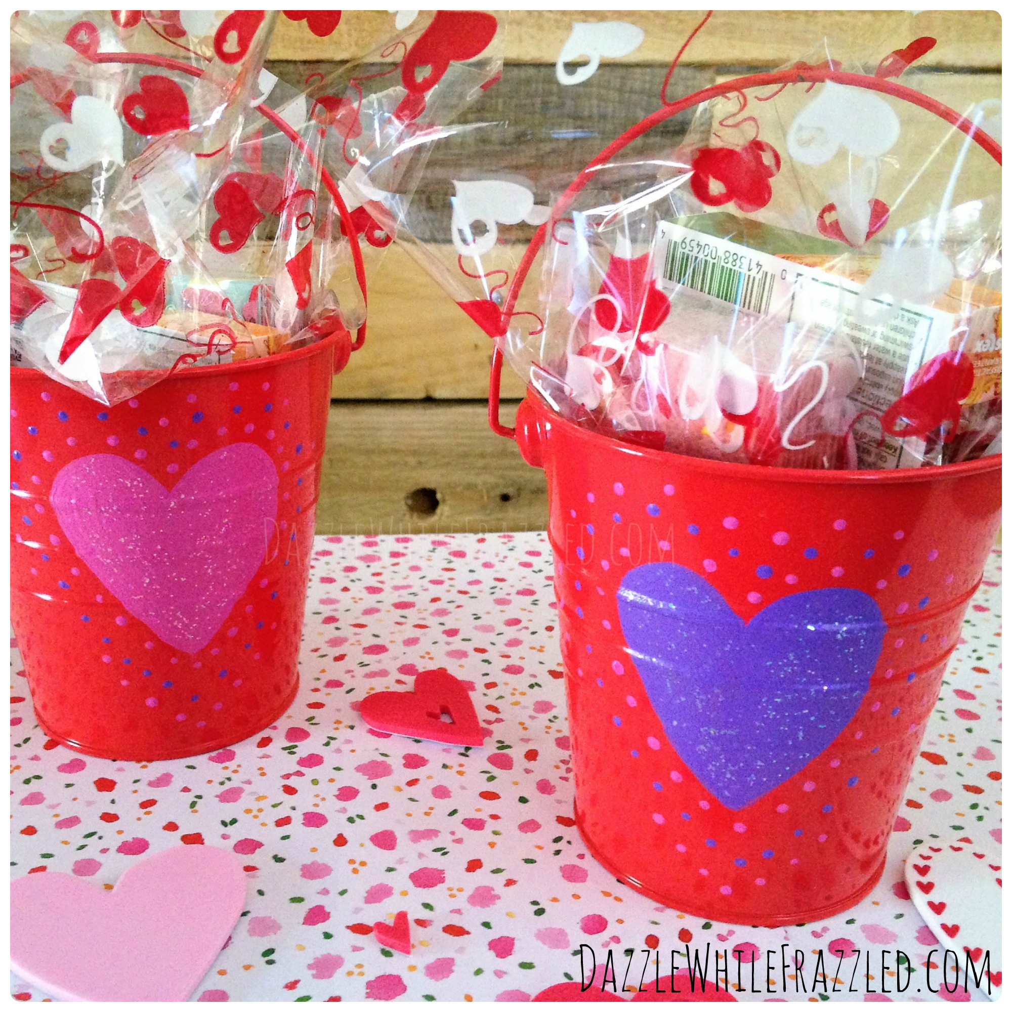 Use small metal pails and Valentine's Day cellophane paper to make DIY $5 teacher Valentine's Day gifts