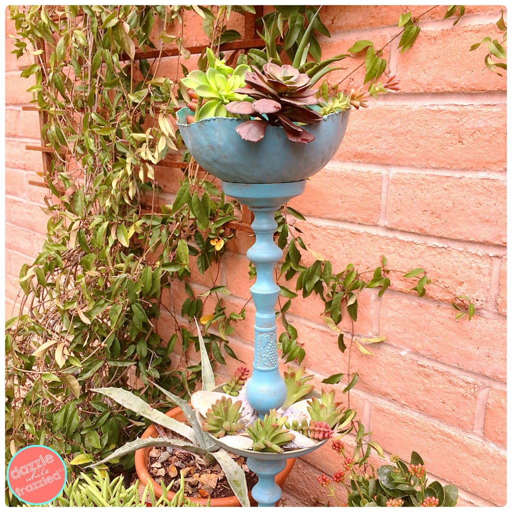 Turn a vintage candlestick into a freestanding candlestick plant stand for the garden.