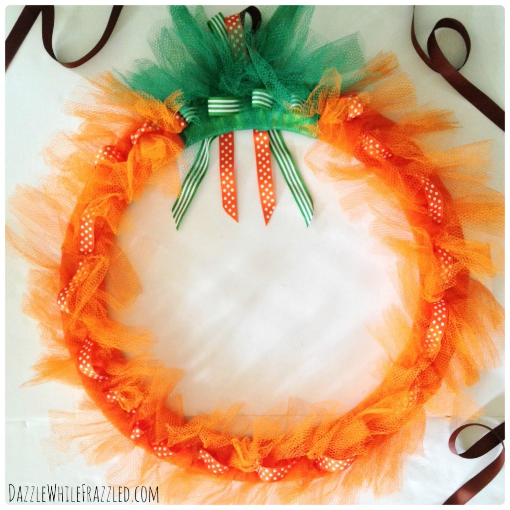 How to make a mesh pumpkin wreath in 5 easy steps.