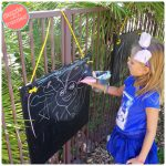 DIY Fence-Mounted Outdoor Chalkboard for Kids