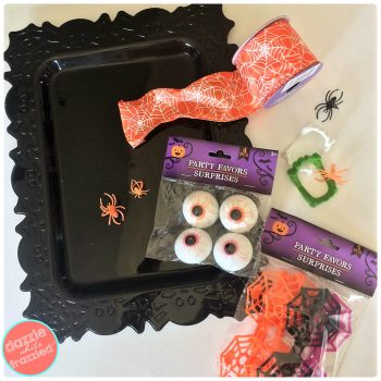 Use Halloween supplies from Dollar Tree to make a DIY Halloween door wreath | DazzleWhileFrazzled.com