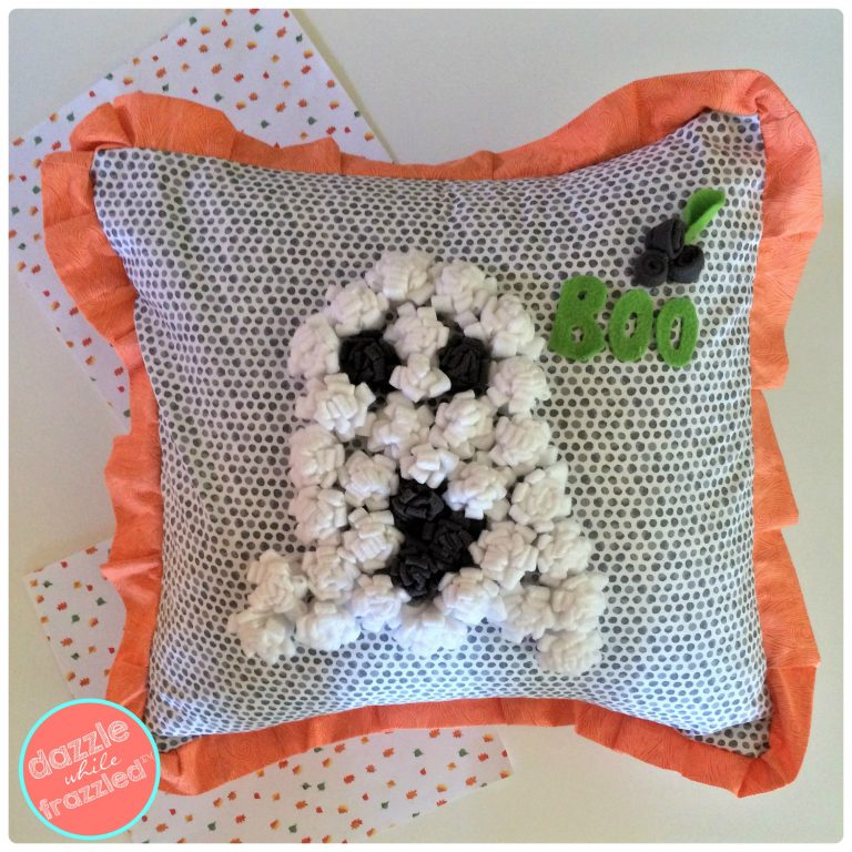BOO! DIY ghost pillow cover made with fleece and felt for Halloween home decor.