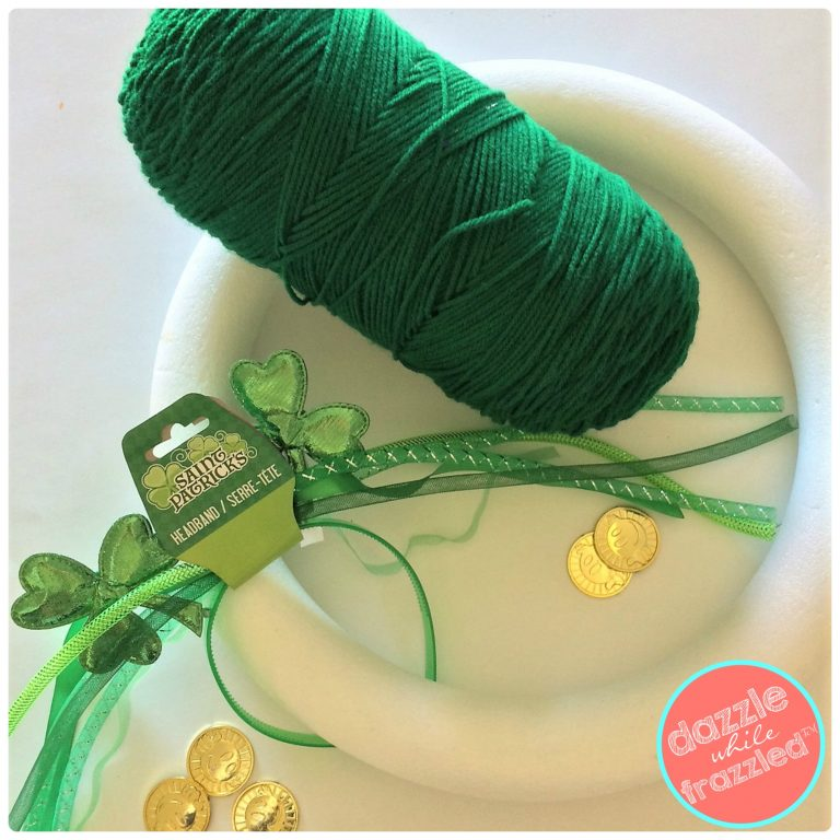 DIY St. Patrick's Day front door wreath using green yarn and dollar store shamrock headbands