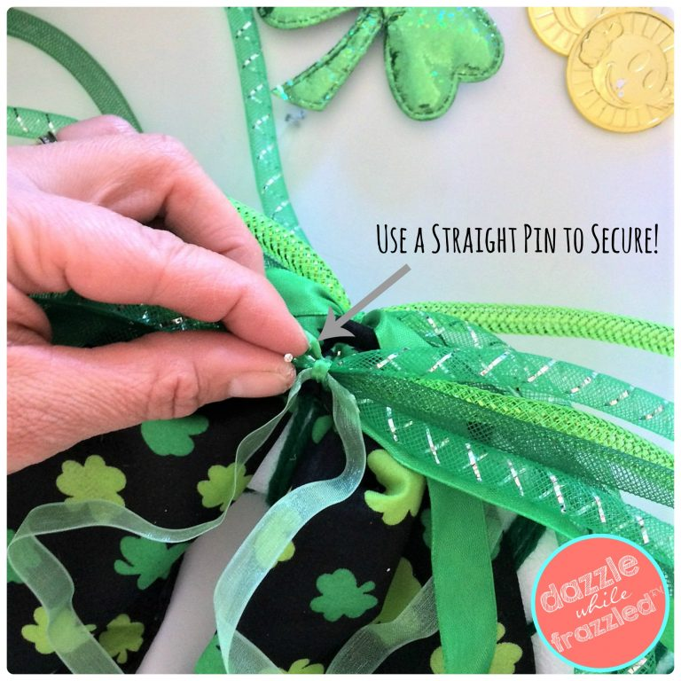 Use straight pins to secure St. Patrick's Day bandana and ribbons to DIY wreath