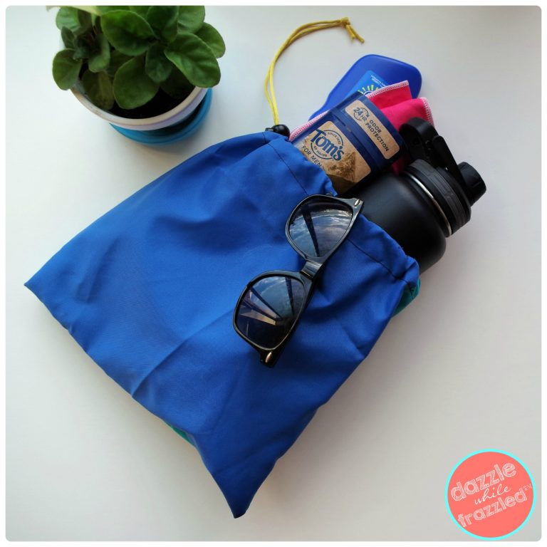 Survive the hot summer with DIY hot climate reusable drawstring tote bag to pack your water bottle, sunscreen, sunglasses and deodorant.
