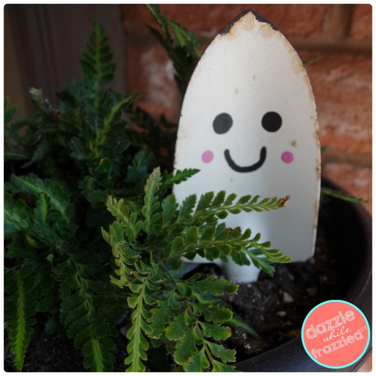 DIY Halloween plant stake from old gardening shovel turned into a friendly Halloween ghost.