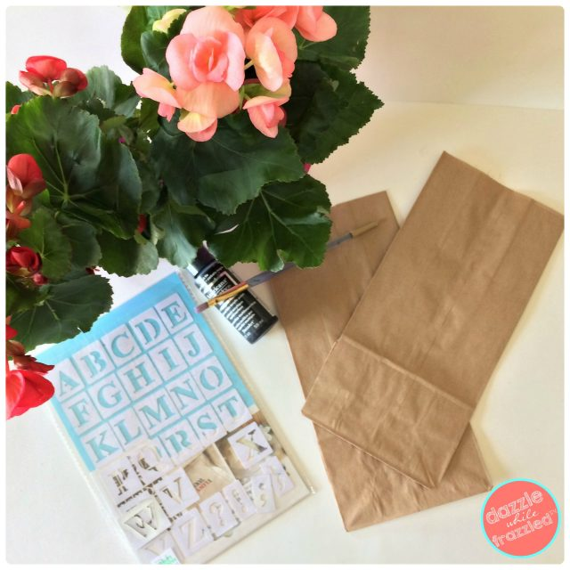 Brown paper lunch bags and letter stencils for cute, easy potted plant gift bags for Valentine's Day.