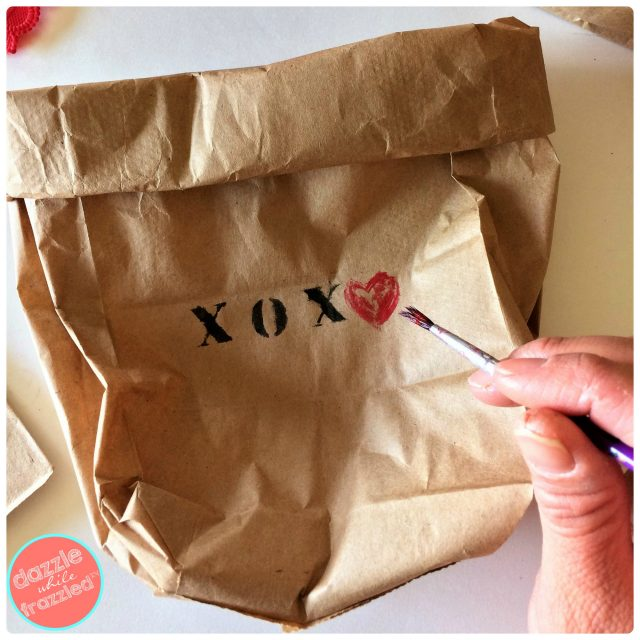 Use letter stencils or letter stamps to write vintage-inspired message on front of brown paper bag as way to gift a potted plant.