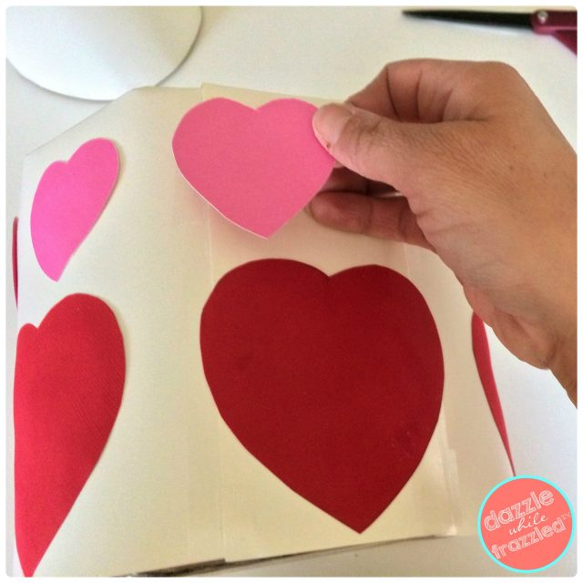 Cover DIY tiered wedding cake Valentine's Day card holder with large heart cutouts or stickers.