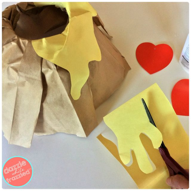 Use yellow scrapbook construction paper to make lava for kids volcano Valentine's Day card box holder.