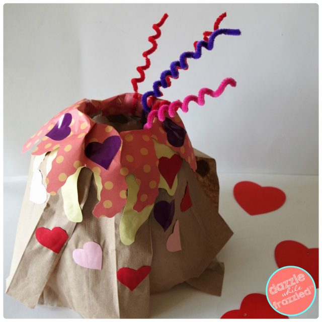Add pipe cleaner to sides of brown paper bag volcano kids Valentine's Day card box holder.