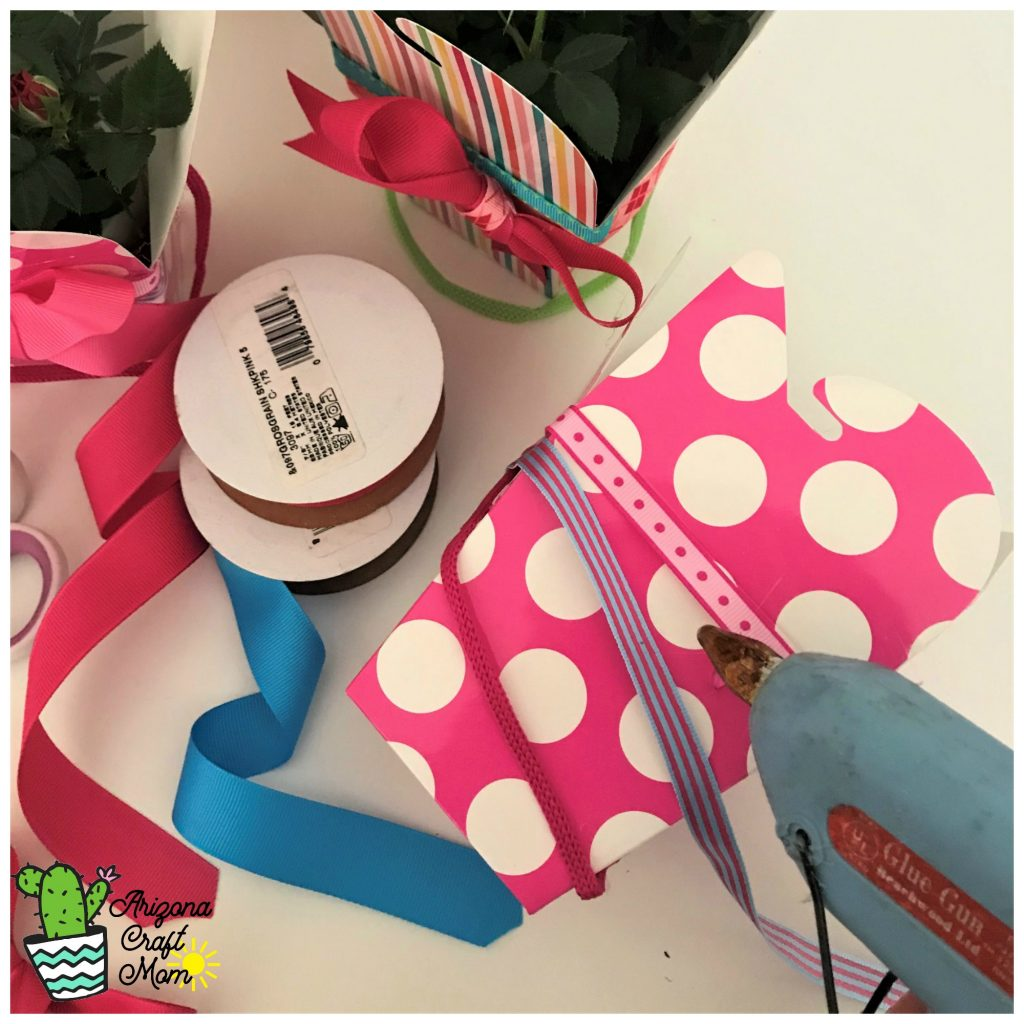 Decorate a chinese takeout party favor box with grosgrain ribbon for DIY pretty potted plant gift.
